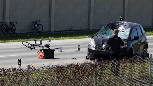 distracted driver hits a group of bicyclist, killing one, injuring five