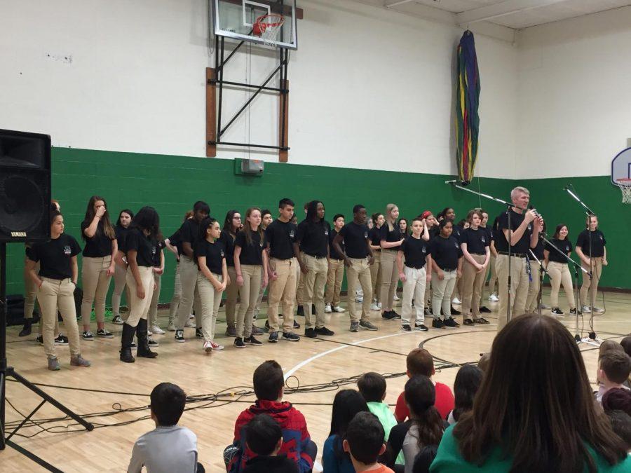 Choir+teacher+Mr.+Bright%2C+introducing+Vocal+Dimensions